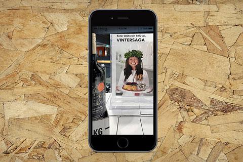 iPhone Kind als Werbung Vintersaga Glühwein